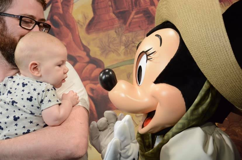 Minnie Mouse and a baby at Disney World https://oddhogg.com/